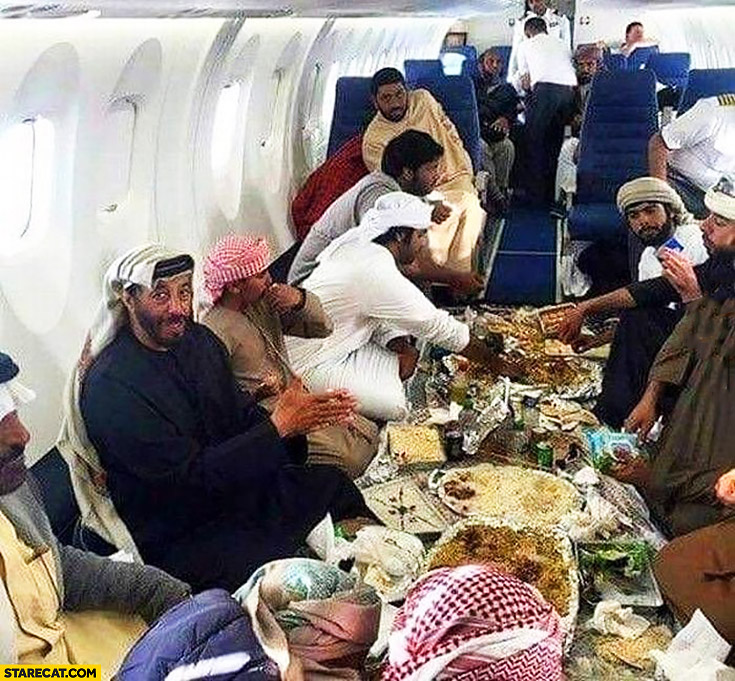 Arabian airlines business class table full of food