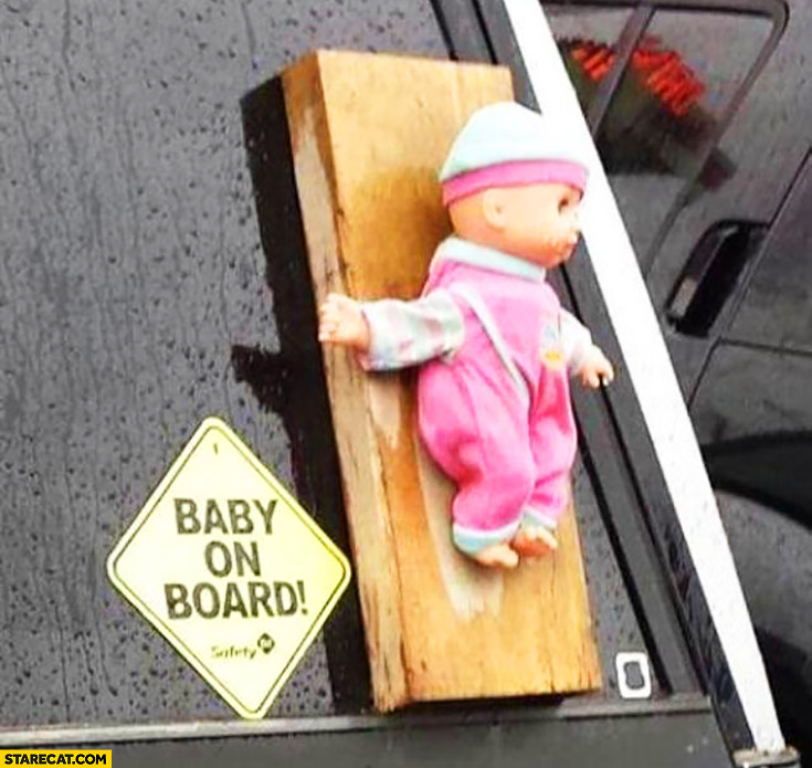 Baby on board baby doll attached to a board