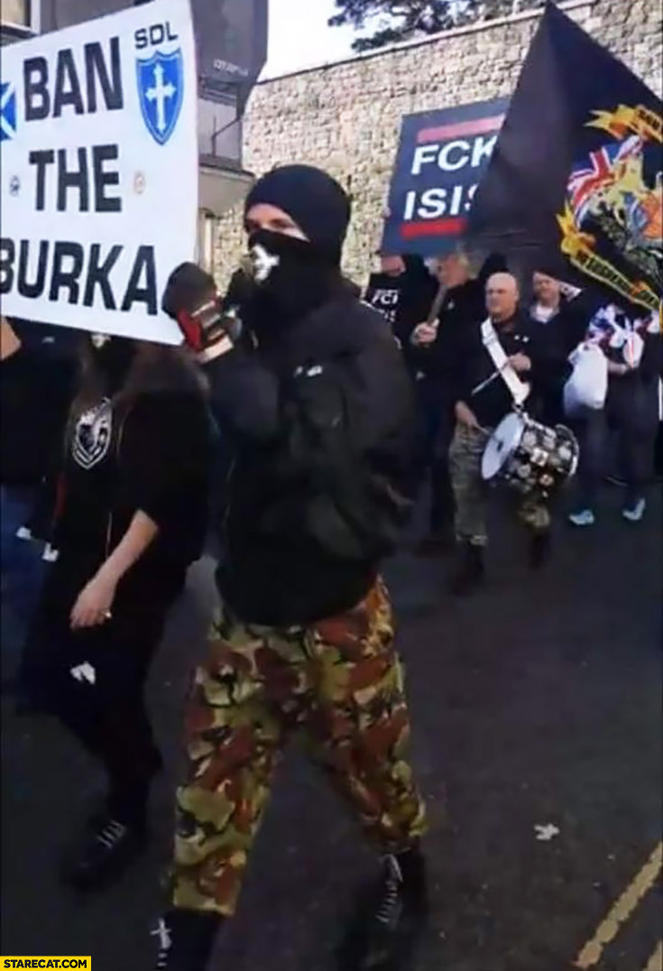 Ban the burka. Protester with covered face fail