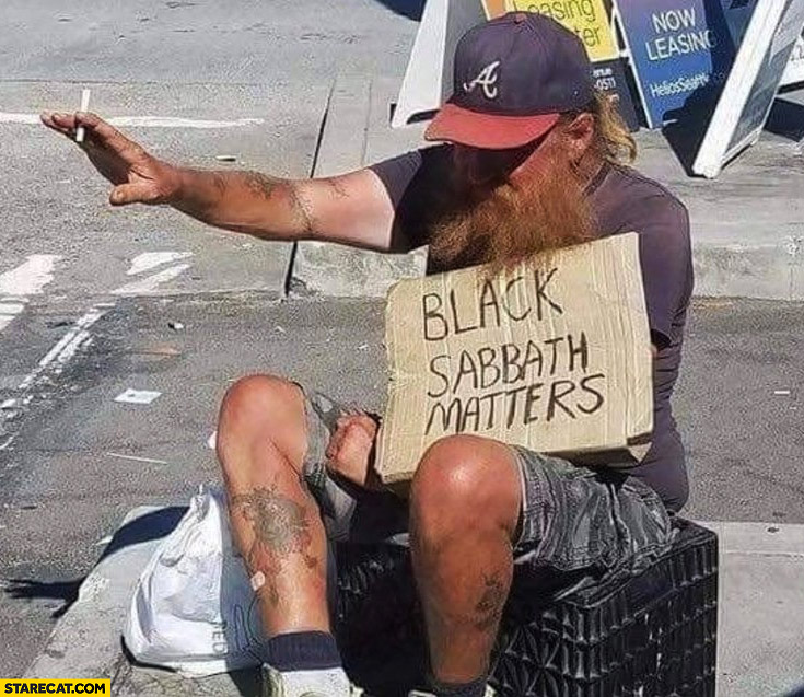 Black Sabbath matters guy with a sign