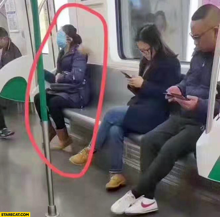 Chinese woman on subway whole face covered facemask against viruses