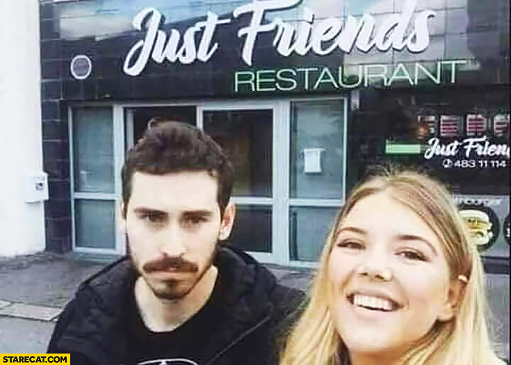Couple in front of just friends restaurant