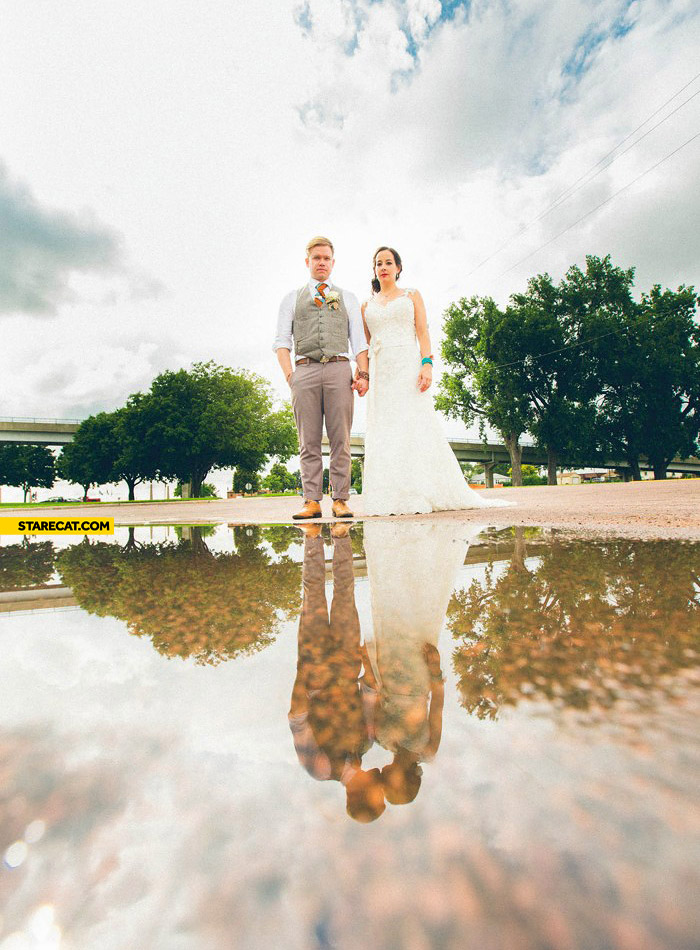 Creative wedding photo kiss in a reflection
