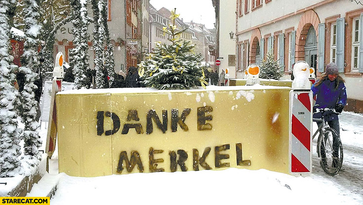 Danke Merkel written sprayed on concrete blocks security against terrorist attacks