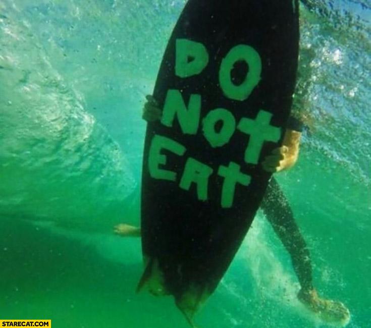 Do not eat written on a surfboard bottom message to shark