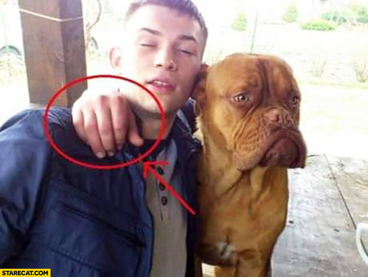 Dog with a guy hand instead of a paw