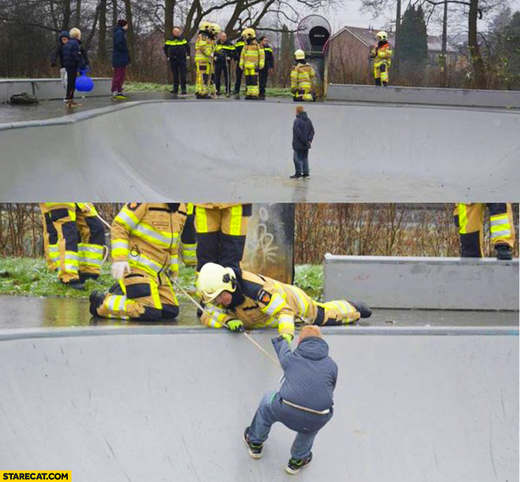 Firemen rescuing fat boy out of skate bowl