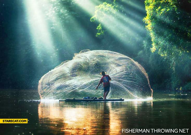 Fisherman throwing net