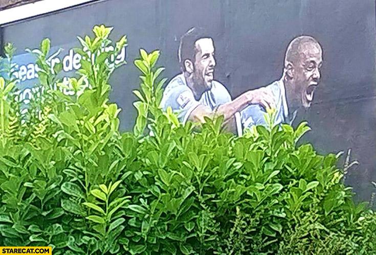 Football AD two men behind bushes fail