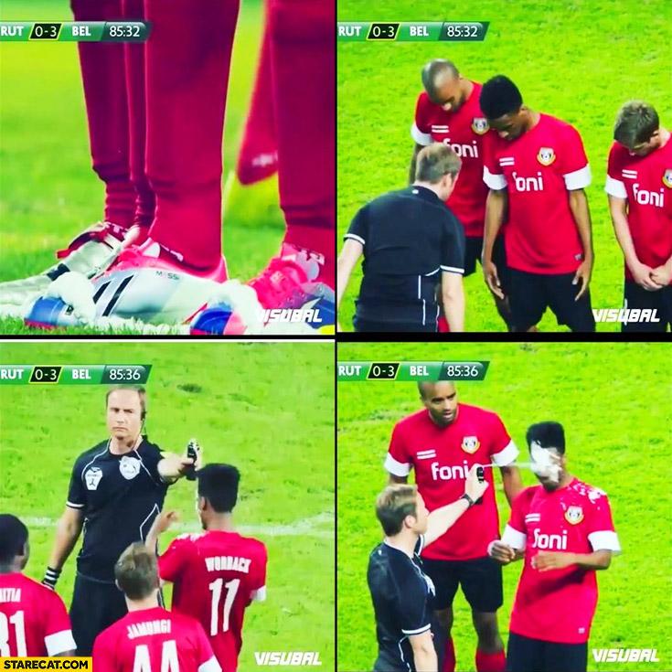 Football spray referee sprayed on players face