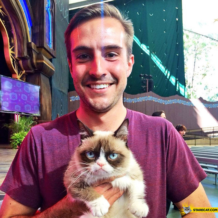 Grumpy Cat with ridiculously photogenic guy