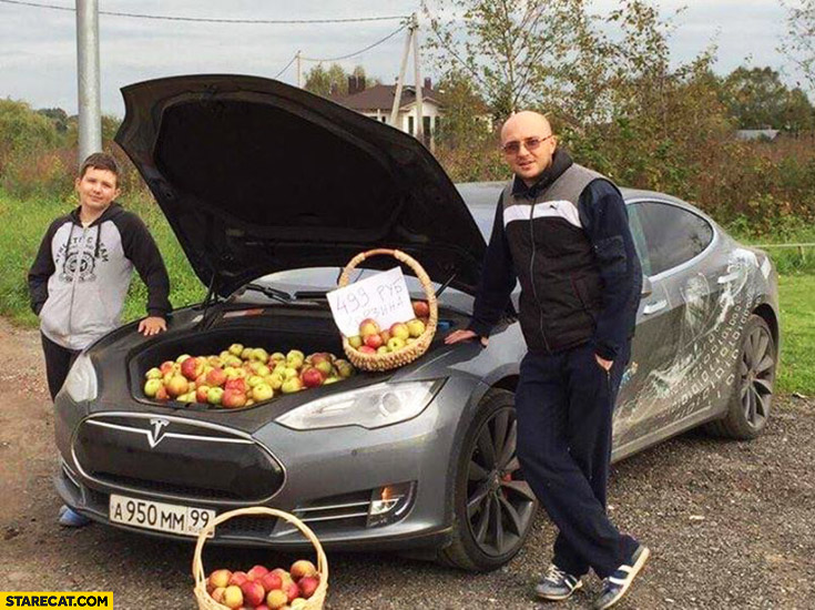 Guys selling apples out of Tesla Model S front trunk