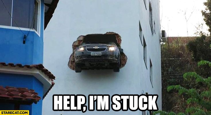 Help I'm stuck car hanging on a building wall out of nowhere