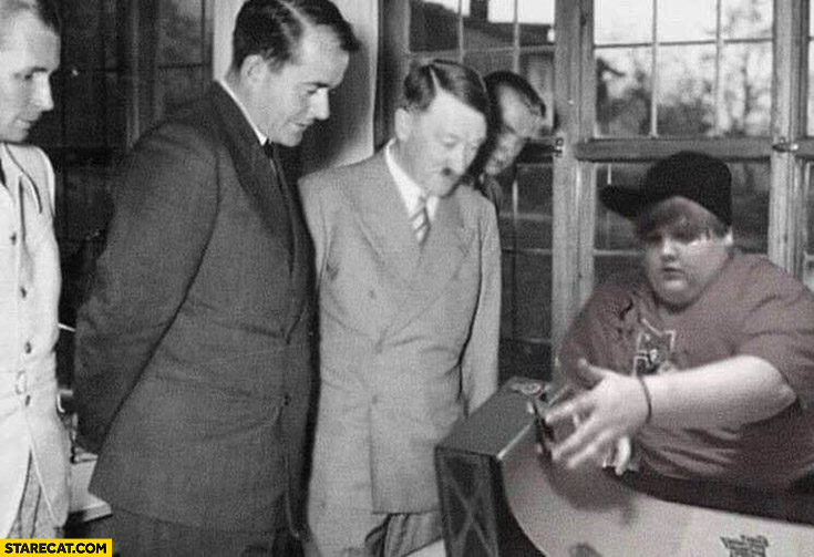 Hitler watching fat kid riding a fingerboard photoshopped