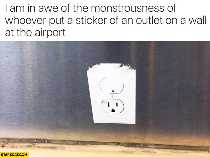 I am in awe of the monstousness of whoever put a sticker of an outlet on a wall at the airport