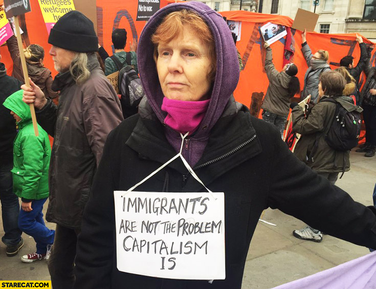Immigrants are not the problem, capitalism is. Woman protesting