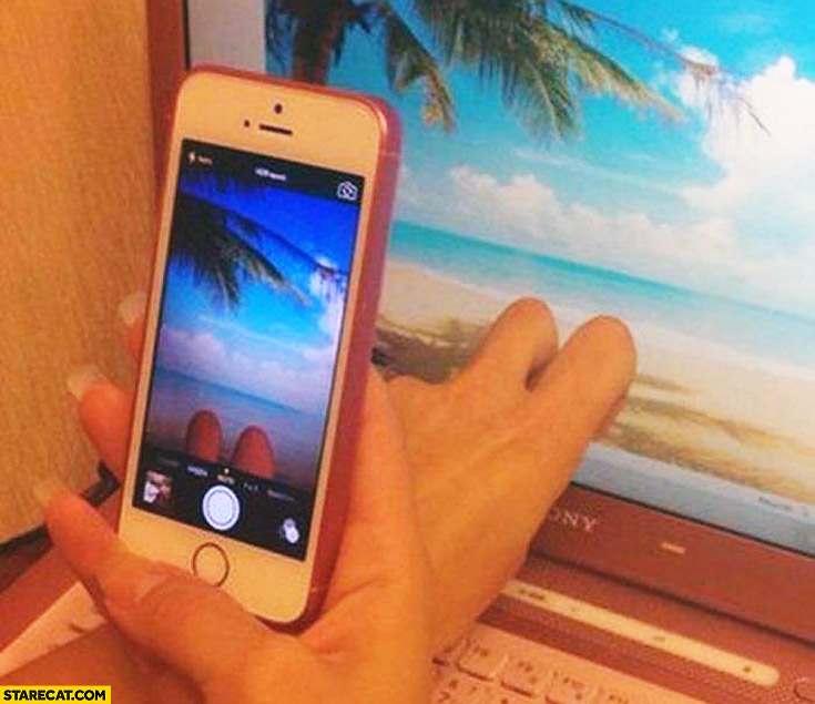Instagram photo fingers laptop as legs on a beach