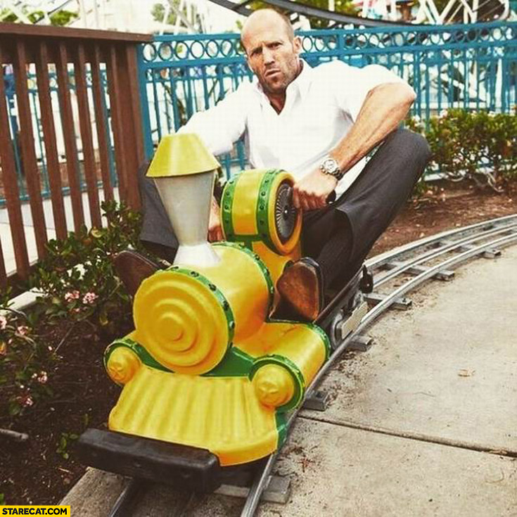 Jason Statham on a toy choo choo