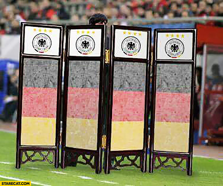 Joachim Loew hidden behind dressing curtain