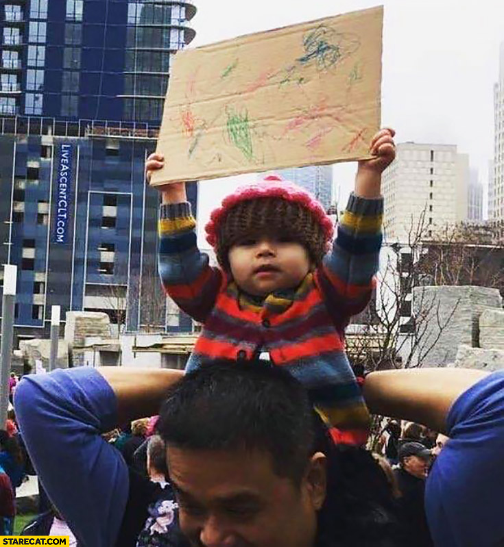 Kid protester carrying self made sign painting