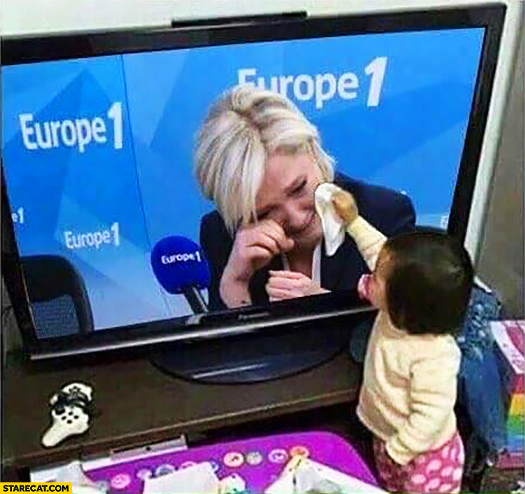 Kid with a tissue trying to cheer up crying Marine Le Pen