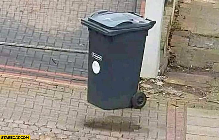 Levitating bin trash can optical illusion