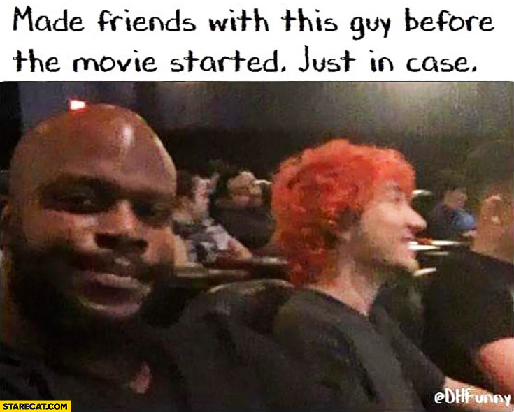 Made friends with this guy before the movie started just in case orange hair cinema shootings