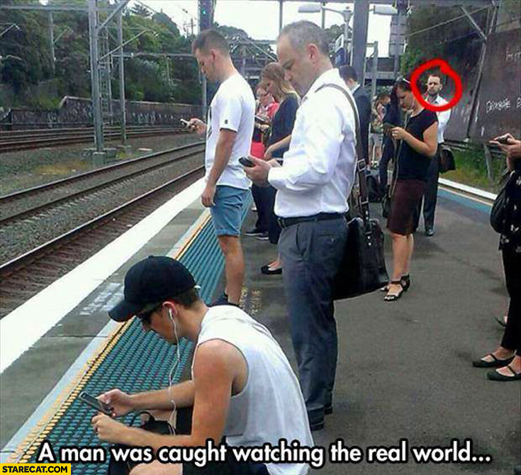 Man was caught watching the real world others looking at their phones