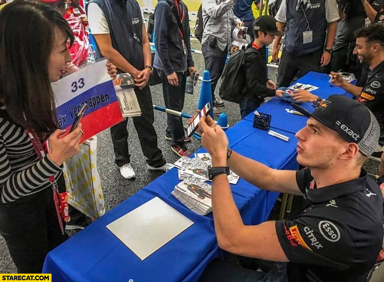 Max Verstappen explaining Dutch flag to a girl who has Russian flag