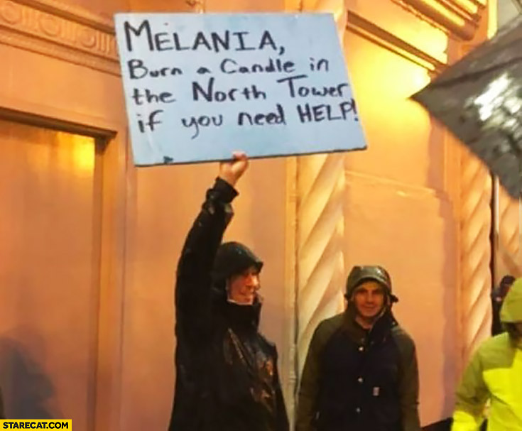 Melania burn a candle in the North Tower if ou need help Trump protesters sign