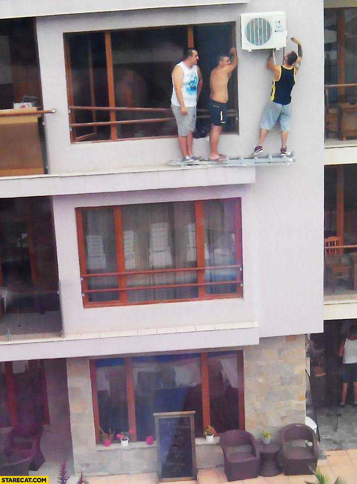 Men fixing air condition ladder fail