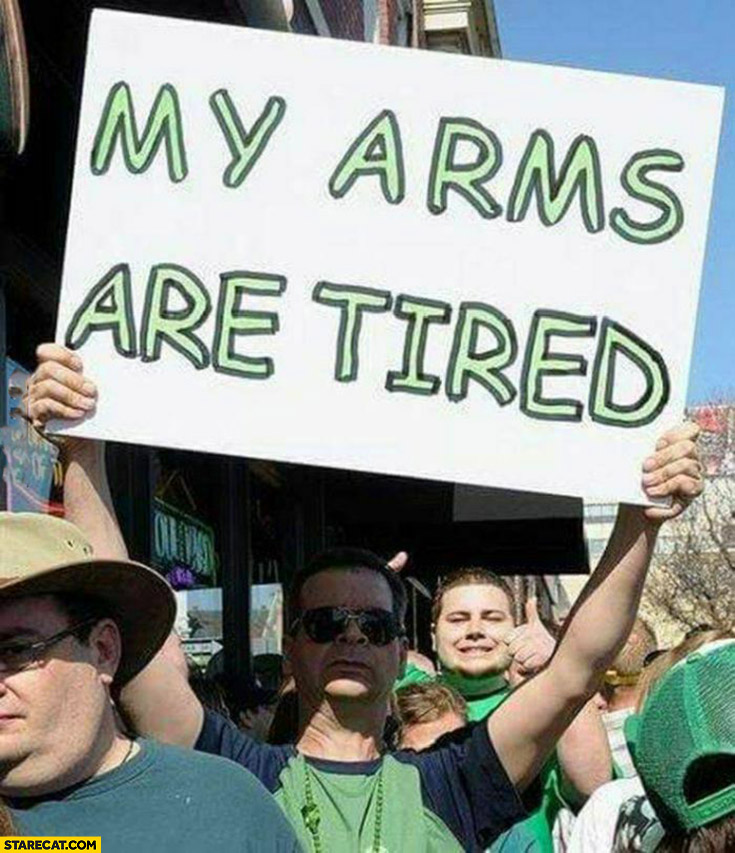 My arms are tired protester man sign
