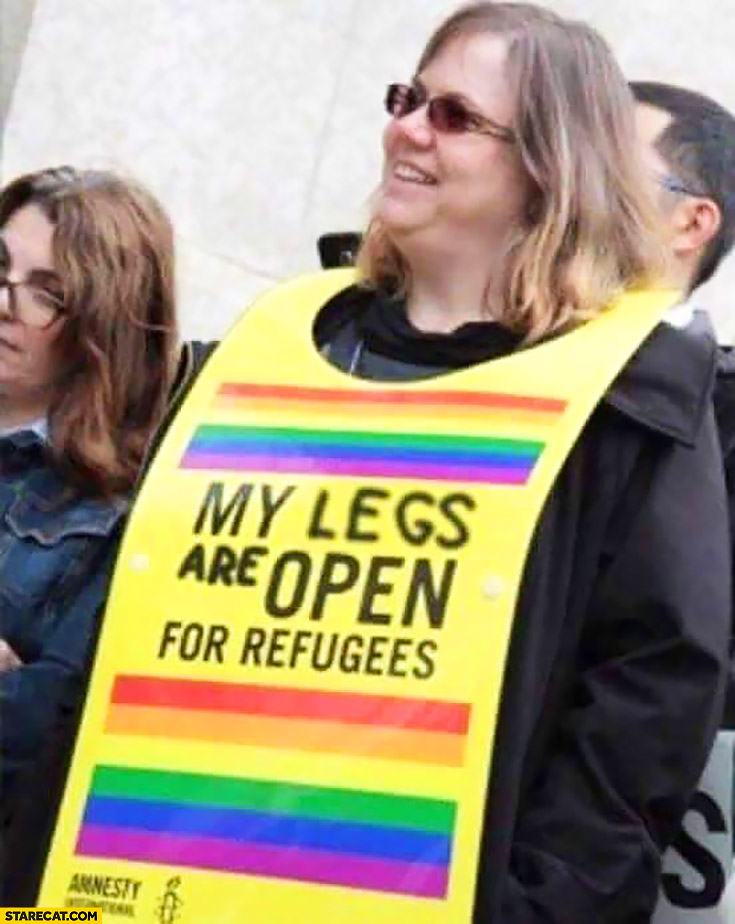 My legs are open for refugees. Woman sign Amnesty International protest