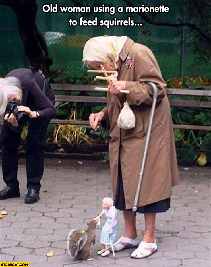 Old woman using a marionette to feed squirrels