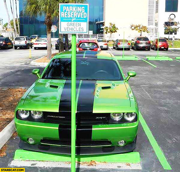Parking reserved for green vehicles Dodge Challenger SRT muscle car parked