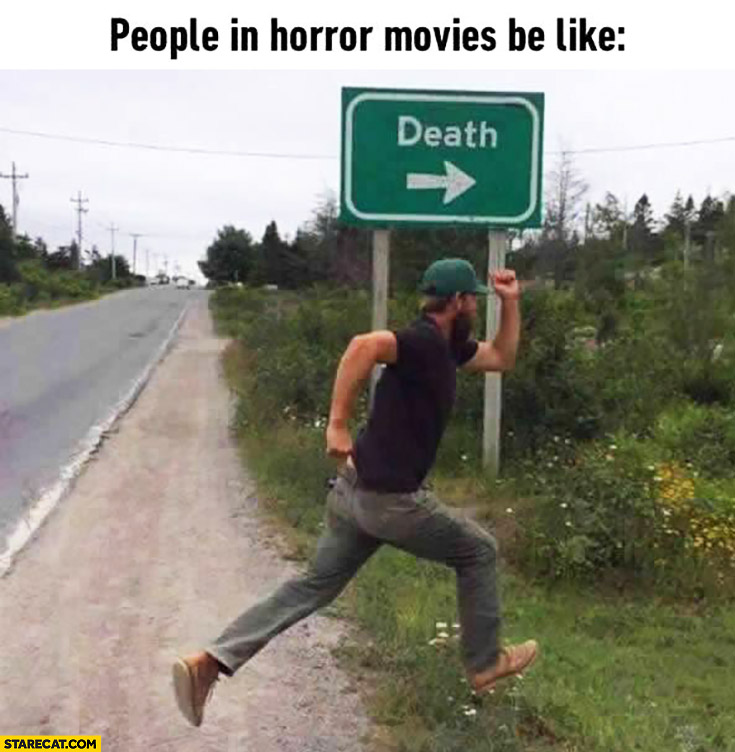 People in horror movies be like running towards death sign