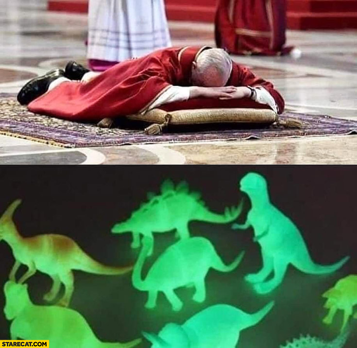 Pope lying on the floor to see glowing dinosaurs