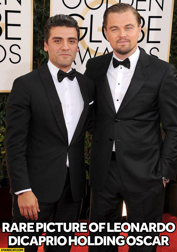 Rare picture of Leonardo DiCaprio holding Oscar Isaac
