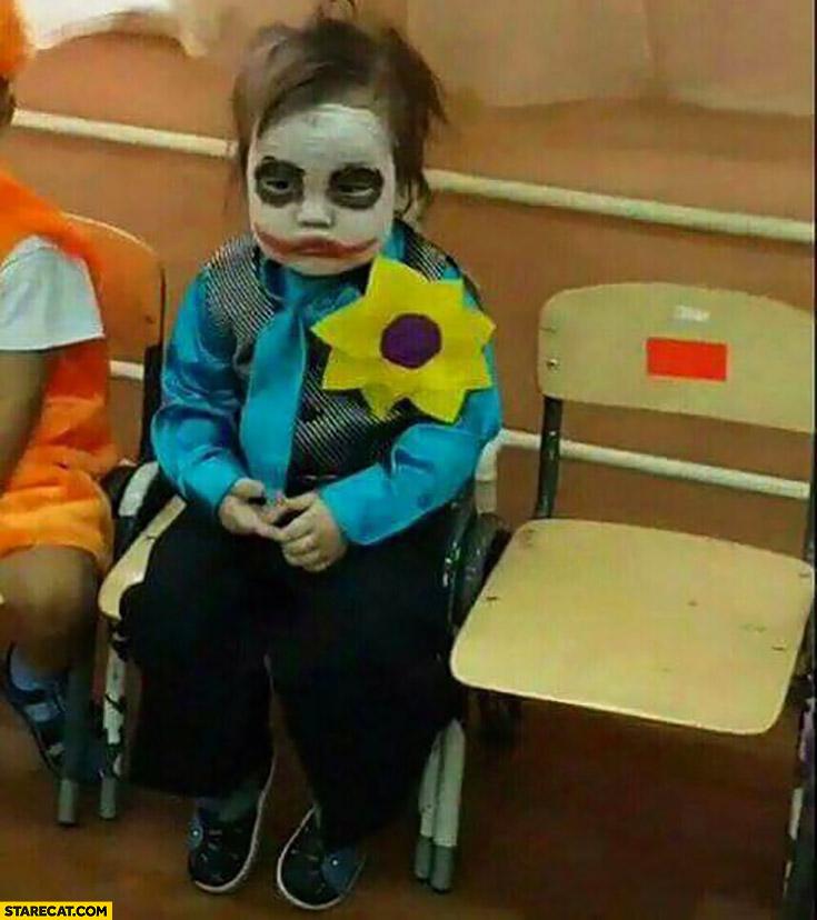 Sad kid dressed as Joker cosplay