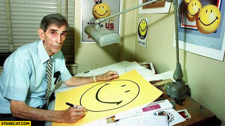 Sad man painting happy smiley faces