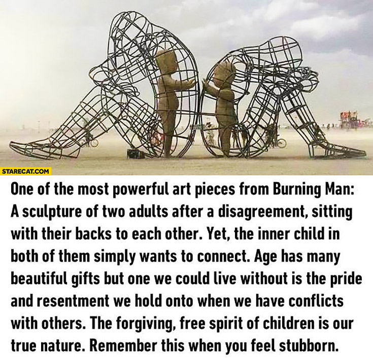 Sculpture from burning man two adults sitting with their backs to each other inner child in both of them wants to connect
