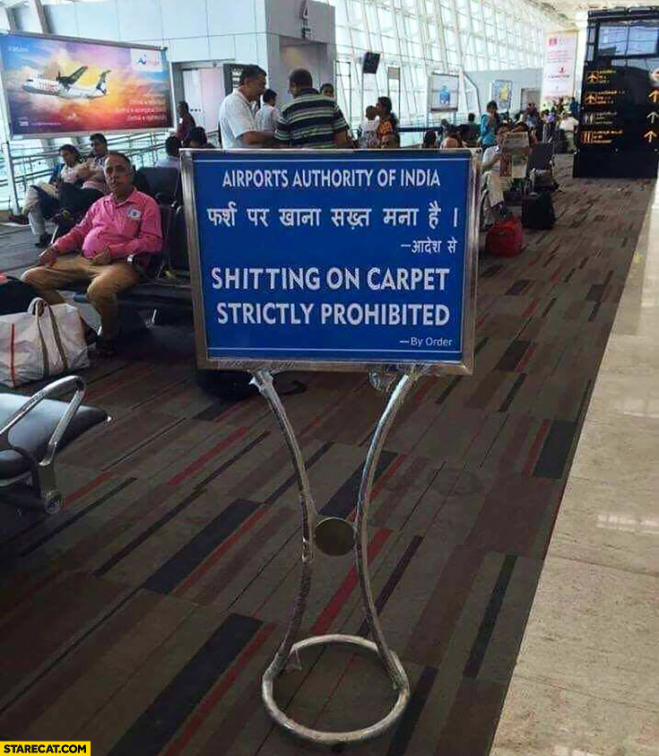 Shitting on carpet strictry prohibited. Airports authority of India sign warning