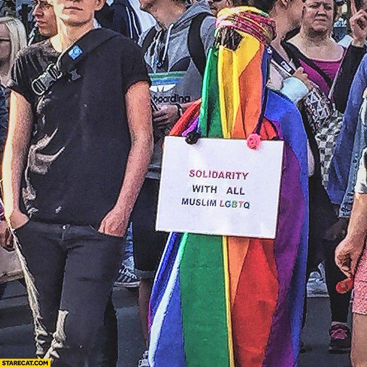 Solidarity with all muslim LGBTQ protester muslim wearing colorful burqa