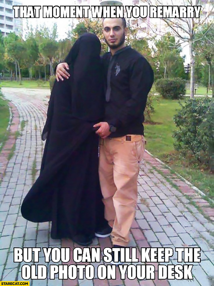 That moment when you remarry but you can still keep the old photo on your desk. Muslim woman wearing burka