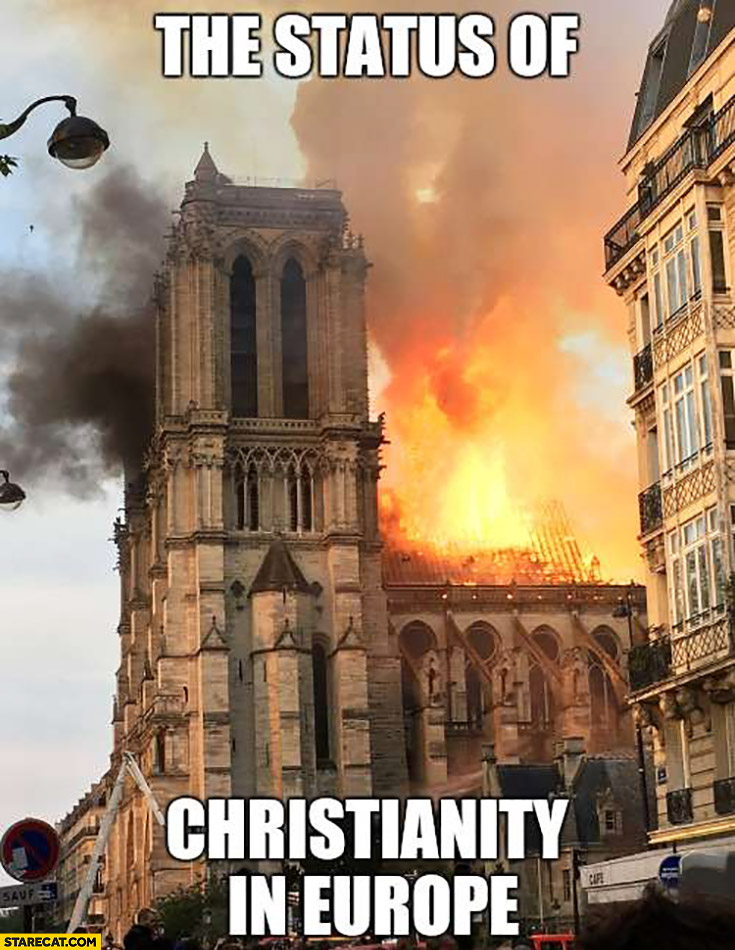 The status of christianity in Europe: Notre Dame cathedral on fire burning