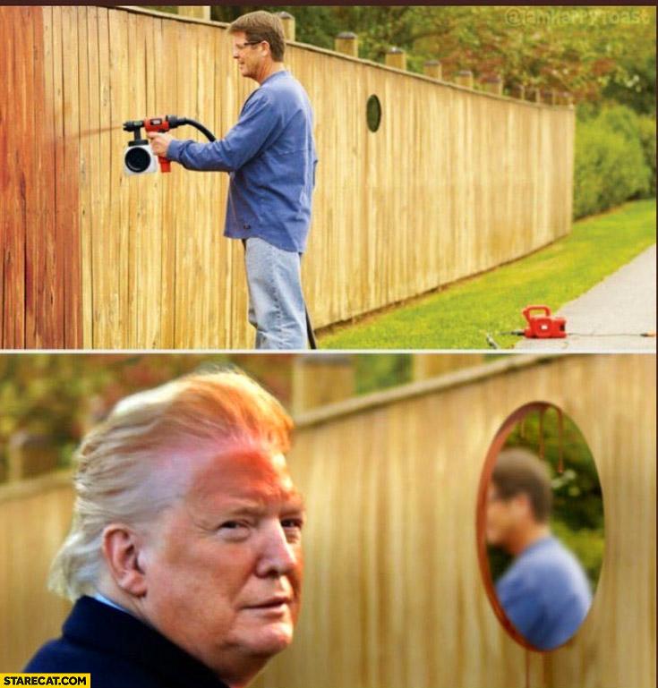Trump orange face fence painting hole