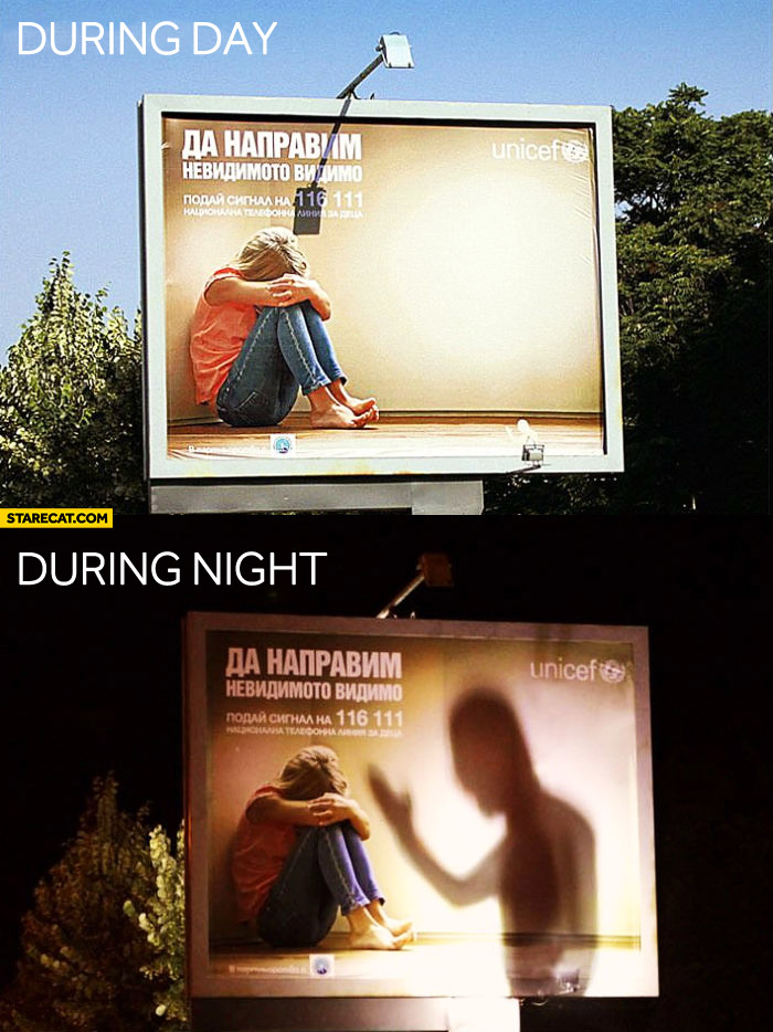 Unicef billboard during day during night
