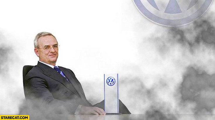 Volkswagen CEO smiling in fumes black smoke