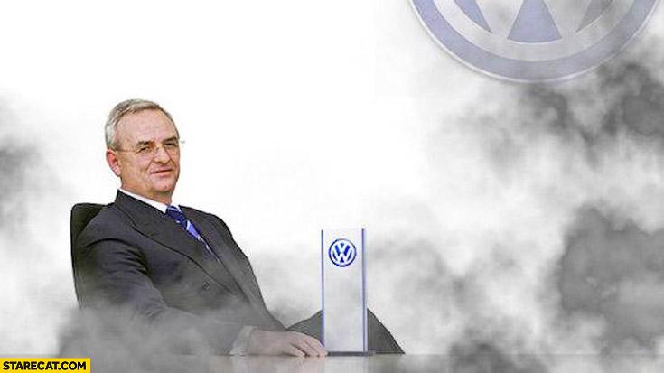 Volkswagen CEO smiling in fumes black smoke