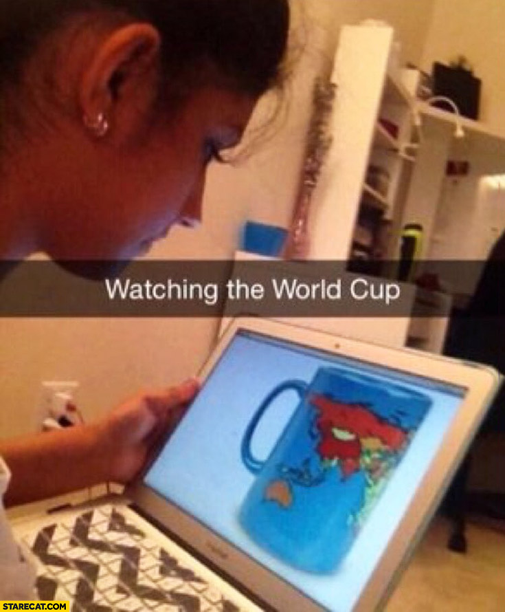 Watching the World Cup. Girl is watching cup with map of the world